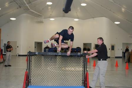 Police recruit during obstacle course