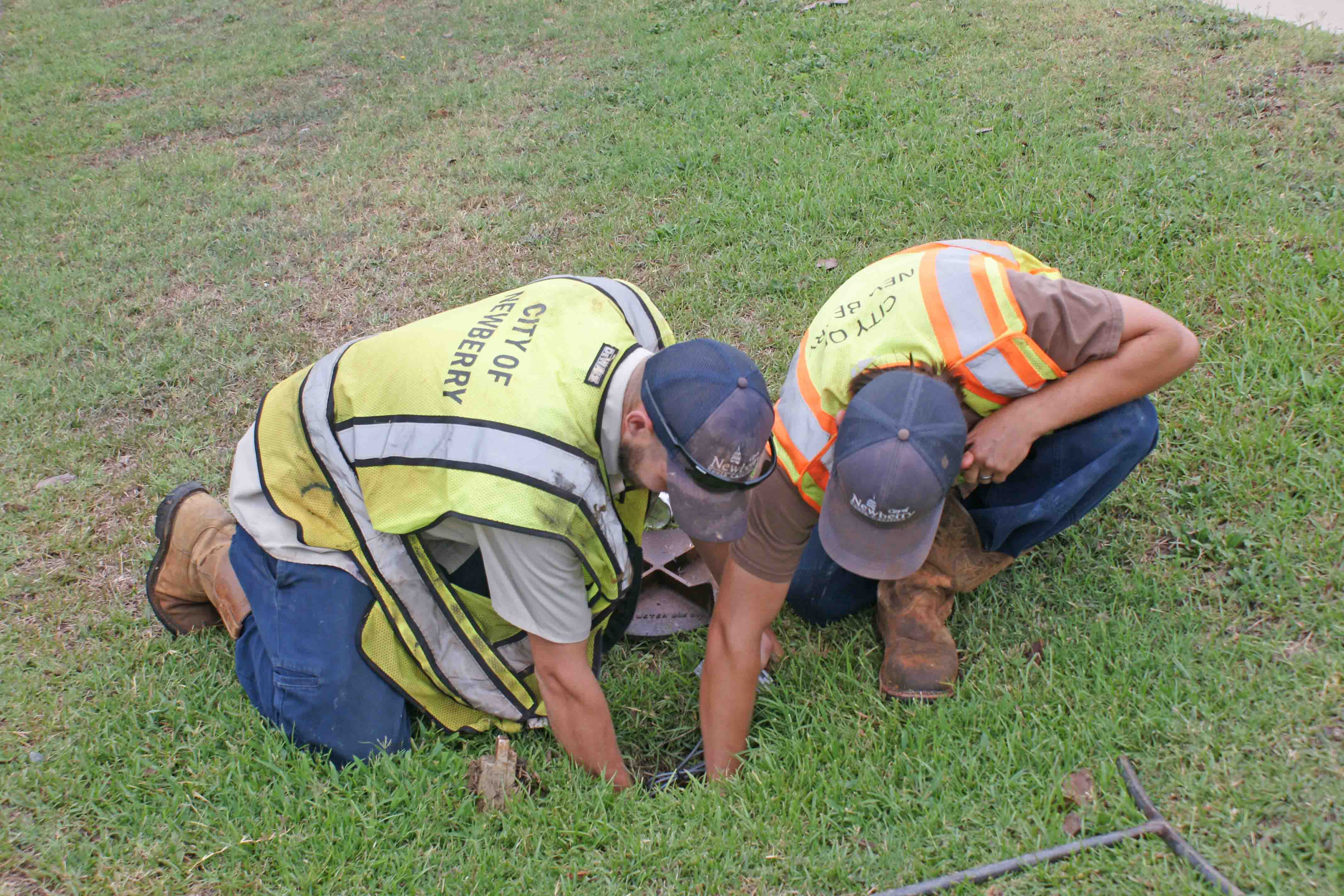 City of Newberry sewer employees changing out a water meter