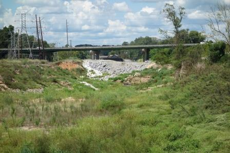 Temporary repairs to the breached Columbia Canal dike remain visible in September 2016